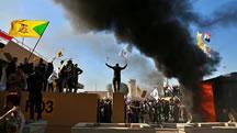 حمله معترضان به سفارت آمريکا در عراق